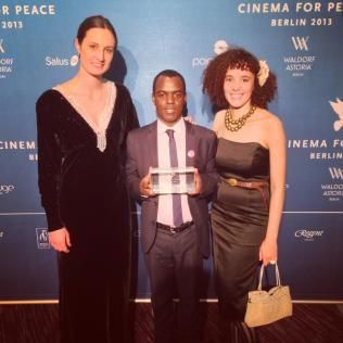 BERLIN: In February 2013 Call Me Kuchu and Ugandan activist group, Sexual Minorities Uganda (co-founded by David Kato) were both honored with the International Human Rights Film Award from the Cinema for Peace Foundation. Here we're grinning after receiving the award with Frank Mugisha, chairman of SMUG and one of the activists featured in the film.